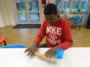 Young person playing with play dough